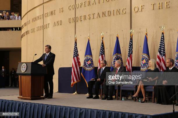 Federal Bureau of Investigation Director Christopher Wray delivers remarks during his installation ceremony with FBI Deputy Director Andrew McCabe US...