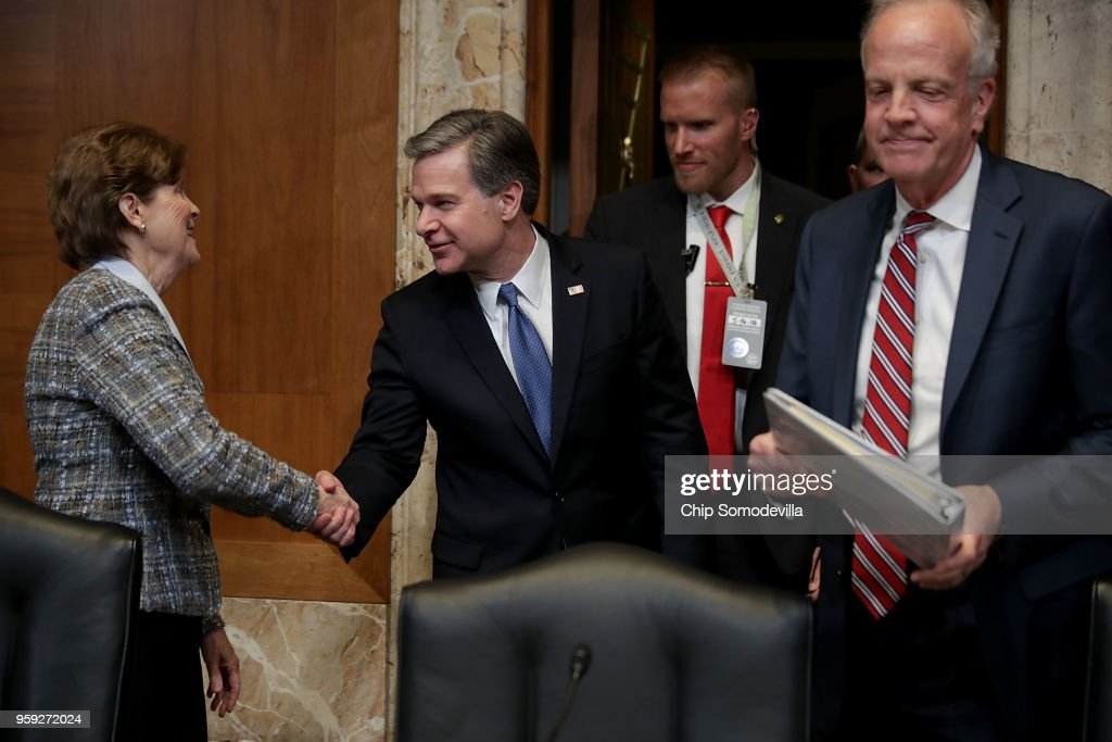 Federal Bureau of Investigation Director Christopher Wray (C) greets the Senate Appropriations Committee's Commerce, Justice, Science, and Related Agencies Subcommittee ranking member Sen. Jean Shaheen (D-NH) (L) and Chairman Jerry Moran (R-KS) (R) before a hearing in the Dirksen Senate Office Building on Capitol Hill May 16, 2018 in Washington, DC. Wray testified about this bureau's FY2019 budget request.