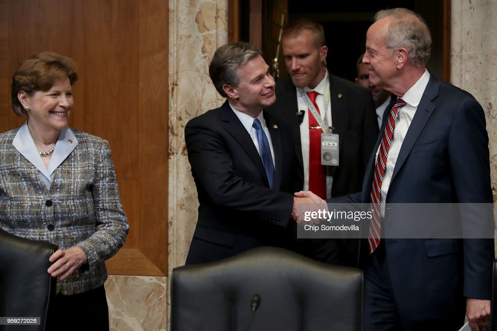 Federal Bureau of Investigation Director Christopher Wray (C) greets the Senate Appropriations Committee's Commerce, Justice, Science, and Related Agencies Subcommittee Chairman Jerry Moran (R-KS) (R) and ranking member Sen. Jean Shaheen (D-NH) (L) before a hearing in the Dirksen Senate Office Building on Capitol Hill May 16, 2018 in Washington, DC. Wray testified about this bureau's FY2019 budget request.