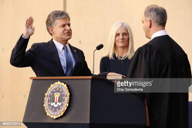 Federal Bureau of Investigation Director Christopher Wray is ceremonially sworn in to office by US District Court Judge Joseph Bianco as Wray's wife...