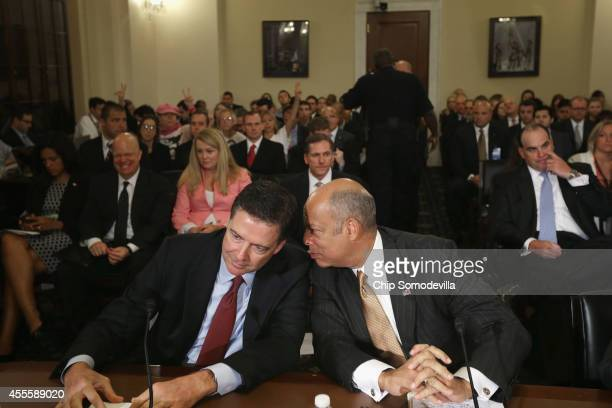 Federal Bureau of Investigation Director James Comey and Homeland Security Secretary Jeh Johnson prepare to testify before the House Homeland...