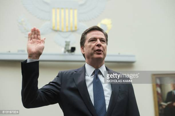 Federal Bureau of Investigation director James Comey is swornin before giving testimony before the House Judiciary Committee on the encryption of the...