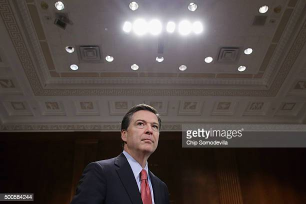 Federal Bureau of Investigation Director James Comey prepares to testify before the Senate Judicary Committee in the Dirksen Senate Office Building...