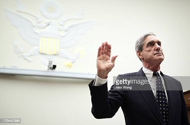 Federal Bureau of Investigation Director Robert Mueller is sworn in during a hearing before the House Judiciary Committee June 13 2013 on Capitol...
