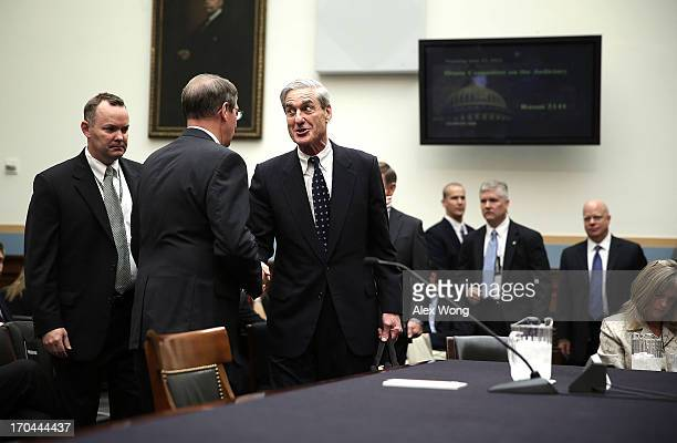 Federal Bureau of Investigation Director Robert Mueller shakes hands with committee chairman Rep Bob Goodlatte as he arrives at a hearing before the...
