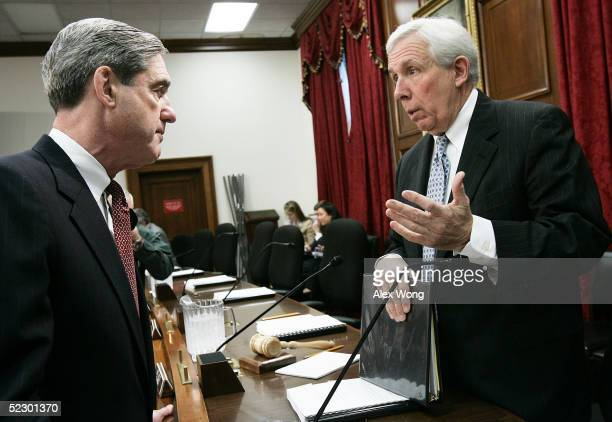 Federal Bureau of Investigation Director Robert Mueller speaks with Chairman Rep Frank Wolf prior to a hearing before a House Appropriations...