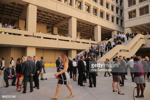 Federal Bureau of Investigation employees return to work following the installation ceremony for FBI Director Christopher Wray at the bureau's...