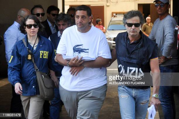 Federal Bureau of Investigation officer and Italian police officer escort Thomas Gambino after he was arrested in Palermo during an police/FBI...