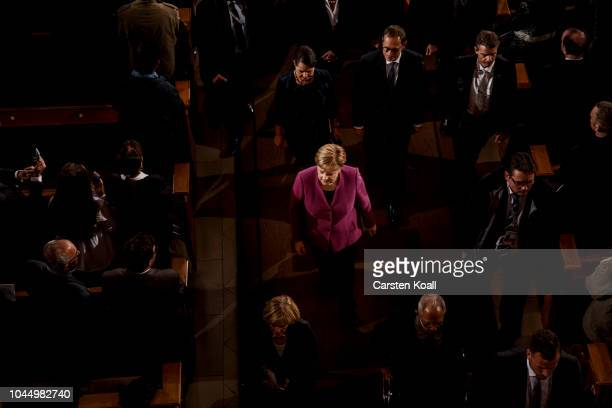 Federal Chancellor and Chairman of the CDU Angela Merkel leaves after the end a service at the Dom cathedral during celebrations to mark German Unity...