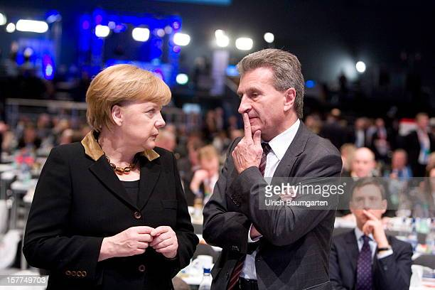 Federal Chancellor Angela Merkel talking with the EUCommissioner Guenther Hermann Oettinger at the CDU federal party convention at Messe Hannover on...