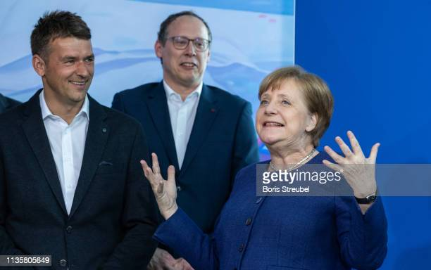 Federal Chancellor Angela Merkel talks with head coach Christian Prokop head coach of the german national handball team at Chancellery on April 08...