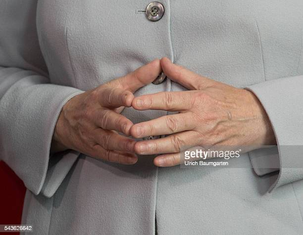 Federal Chancellor female Angela Merkel and her hands with the rhombus during a press conference at the Federal Chancellery