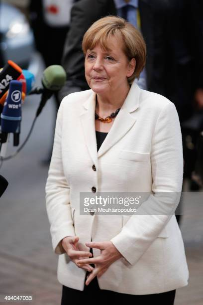Federal Chancellor of Germany Angela Merkel speaks to the media as she arrives for the Informal Dinner of Heads of State or Government held at the...