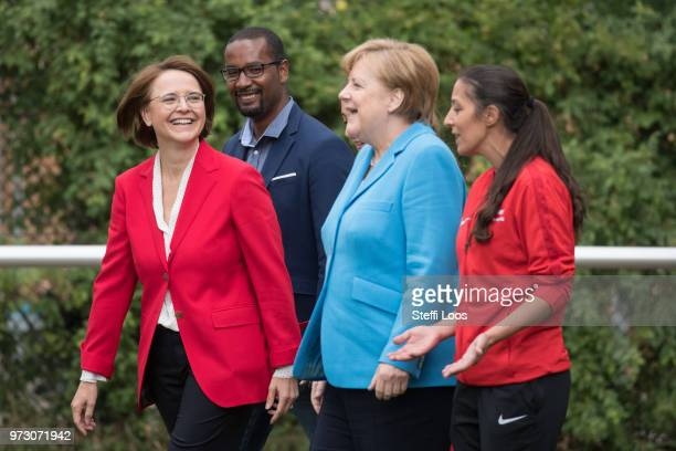 Federal Commissioner for Migration Refugees and Integration Annette WidmannMauz former German National player Cacau German Chancellor Angela Merkel...