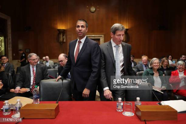 Federal Communication Commission Chairman Ajit Pai and Federal Trade Commission Chairman Joseph Simons prepare to testify before the Senate Financial...