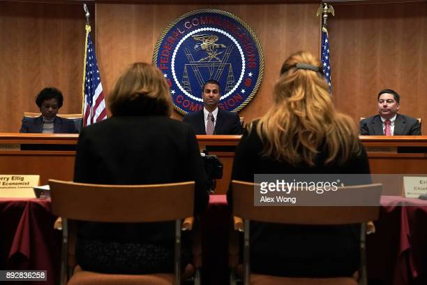 Federal Communications Commission Chairman Ajit Pai and commission members Mignon Clyburn and Michael O'Rielly listen during a commission meeting...