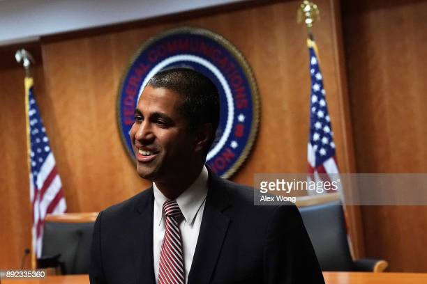 Federal Communications Commission Chairman Ajit Pai arrives at a commission meeting December 14 2017 in Washington DC The FCC is scheduled to vote on...