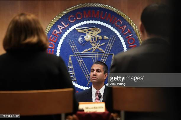 Federal Communications Commission Chairman Ajit Pai listens during a commission meeting December 14 2017 in Washington DC The FCC is scheduled to...