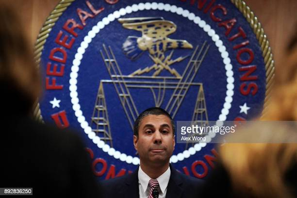 Federal Communications Commission Chairman Ajit Pai listens during a commission meeting December 14 2017 in Washington DC FCC has voted to repeal its...