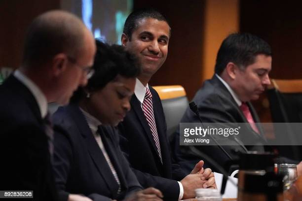 Federal Communications Commission Chairman Ajit Pai smiles during a commission meeting December 14 2017 in Washington DC FCC has voted to repeal its...
