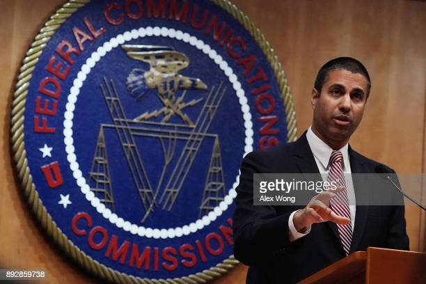 Federal Communications Commission Chairman Ajit Pai speaks to members of the media after a commission meeting December 14 2017 in Washington DC FCC...