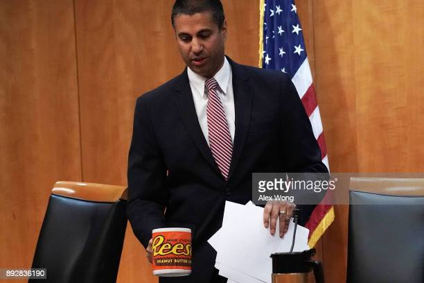 Federal Communications Commission Chairman Ajit Pai takes his seat during a commission meeting December 14 2017 in Washington DC FCC has voted to...