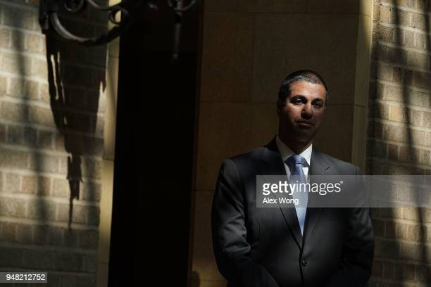 Federal Communications Commission Chairman Ajit Pai waits to be introduced during a forum April 18 2018 in Washington DC FCC Chairman Pai and US...