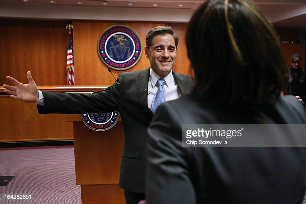 S Federal Communications Commission Chairman Julius Genachowski embraces his assistant Maria Gaglio after he announced he is stepping down at FCC...