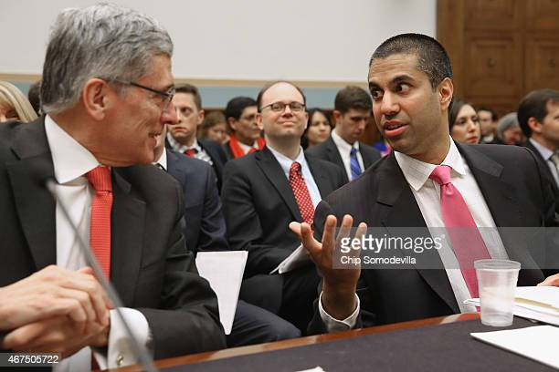 Federal Communications Commission Chairman Tom Wheeler and FCC Commissioner Ajit Pai visit before testifying to the House Judiciary Committee about...