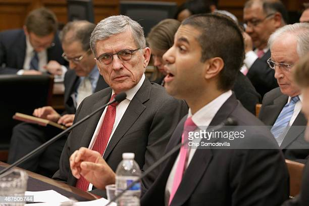 Federal Communications Commission Chairman Tom Wheeler listens to FCC Commissioner Ajit Pai testify before the House Judiciary Committee about...