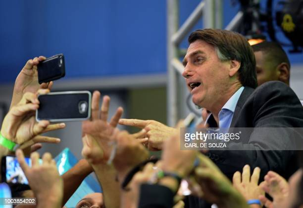 Federal deputy Jair Bolsonaro is greeted by supporters as he launches his campaign for the Brazilian presidency for October's national election in...