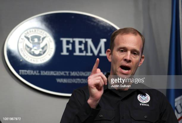 Federal Emergency Management Agency Administrator Brock Long speaks during a briefing on Hurricane Michael at FEMA headquarters on October 12, 2018...