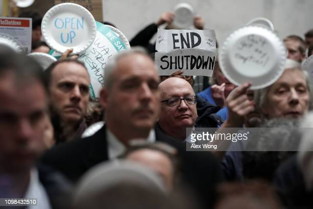 Federal employees hold up signs made with styrofoam plates during a protest at the atrium of Senate Hart Office Building January 23, 2019 on Capitol...
