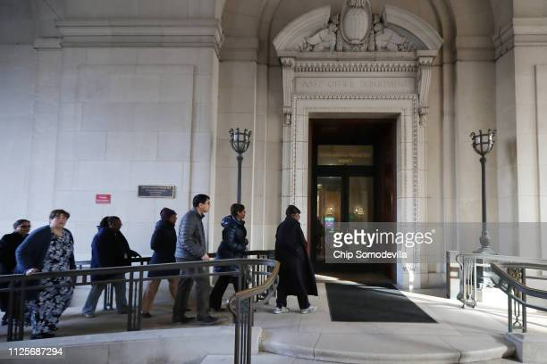 Federal employees return to work at the Environmental Protection Agency headquarters January 28, 2019 in Washington, DC. Furloughed employees...