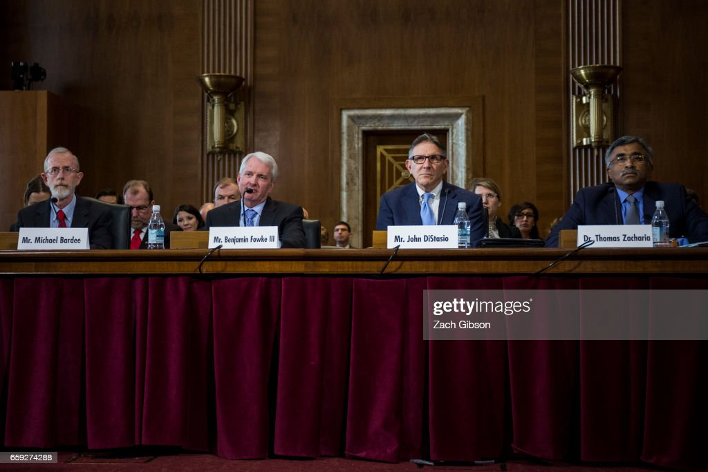 Federal Energy Regulatory Commission's Office of Electric Reliability Director Michael Bardee, Xcel Energy President and CEO Ben Fowke III, Large Public Power Council John DiStasio, and Oak Ridge National Laboratory Director for Science and Technology Thomas Zacharia (from left to right) testify during a Senate Energy Subcommittee hearing discussing cybersecurity threats to the U.S. electrical grid and technology advancements to maximize such threats on Capitol Hill on March 28, 2017 in Washington, D.C.