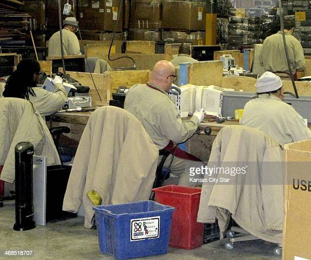 Federal inmates in Leavenworth disassemble old electronics at a prison industries recycling facility