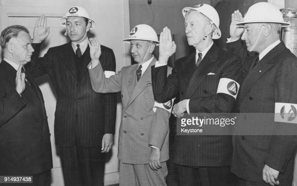 Federal Judge James Francis Thaddeus O'Connor administers the Oath of Office to Air Raid Wardens actor Paul Henreid producer Sol Lesser film pioneer...
