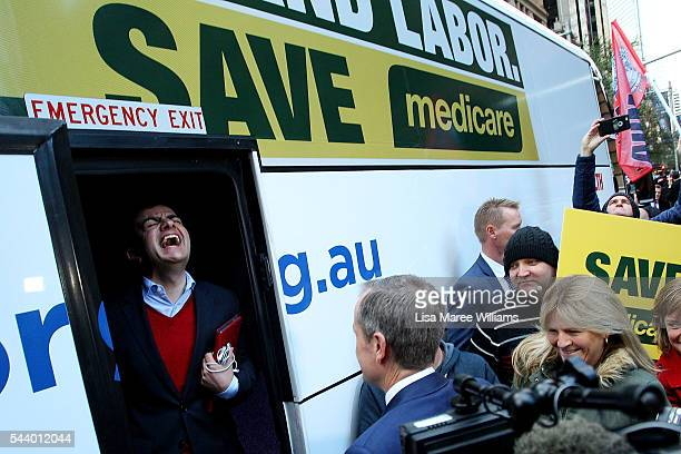 Federal Labor Senator Sam Dastyari laughs as Opposition Leader Australian Labor Party Bill Shorten prepares to board the campaign bus following a...