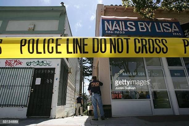 Federal law enforcement agents stand guard during a raid of a medicinal marijuana club June 22, 2005 in San Franciso, California. The U.S. Supreme...