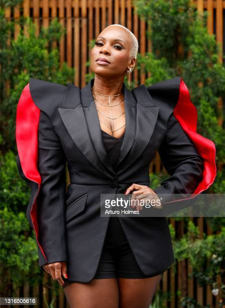 Federal lawyer, writer and producer MiAngel Cody is seen wearing a black and red Alexander McQueen blazer, a black jumpsuit, black high heels and...