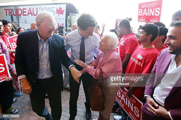 Federal Liberal Leader Justin Trudeau and former Prime Minister Paul Martin greet former Mississauga Mayor Hazel McCallion as he campaigns during the...