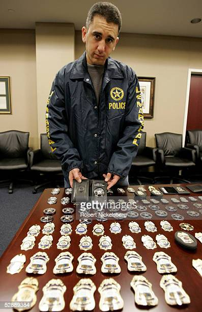 A US Federal Marshal assigned to Immigration and Customs Enforcement display near exact copies of a customs agent's badge confiscated from an illegal...
