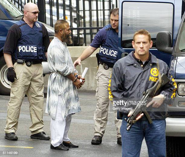 Federal Marshals escort Mohammed Hossain out of the Leo O'Brien Federal building after he was arraigned in Federal Court on August 5 2004 in Albany...