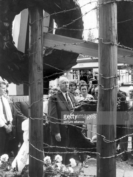Federal minister for allGerman issues Ernst Lemmer laying down a wreath for the deceased Ida Siekmann on the anniversary of the Building of Berlin...