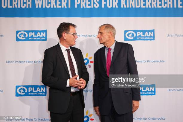 Federal Minister for Economic Cooperation and Development Gerd Mueller and Ulrich Wickert attend the Ulrich Wickert and Peter SchollLatour award at...