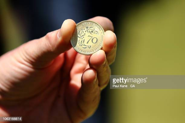 Federal minister Michael Kennan holds the match coin prior to the coin toss during game one of the One Day International series between Australia and...