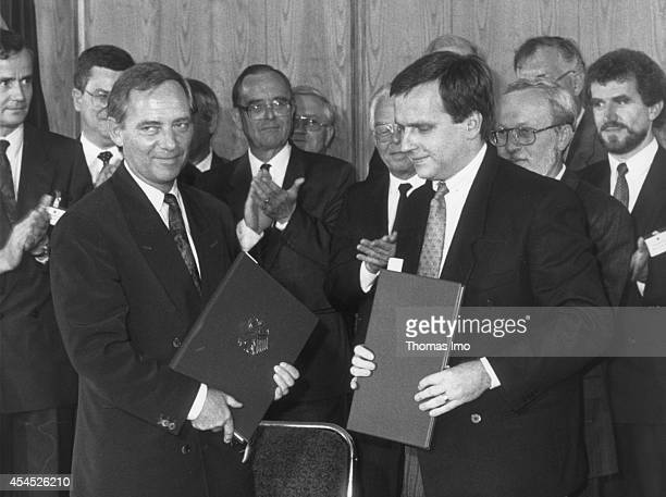 Federal Minister of the Interior Wolfgang Schaeuble and state secretary of East Germany Guenter Krause are signing the Unification Treaty on August...