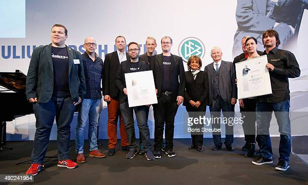 Federal minister Otto Schily and Charlotte Knobloch president of the Jewish Cultural Association of Munich pose with second price winner VfB für Alle...