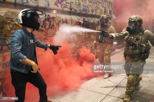 A federal officer pepper sprays a protester in front of the Mark O Hatfield US Courthouse on July 20 2020 in Portland Oregon The federal police...