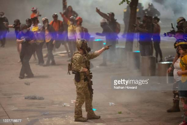 A federal officer points to a protester while clearing the street in front of the Mark O Hatfield US Courthouse on July 20 2020 in Portland Oregon...